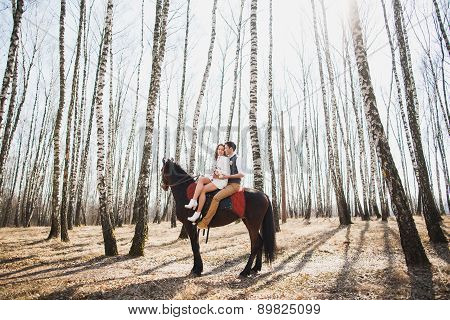 Man And A Woman Riding Together Brown Horse