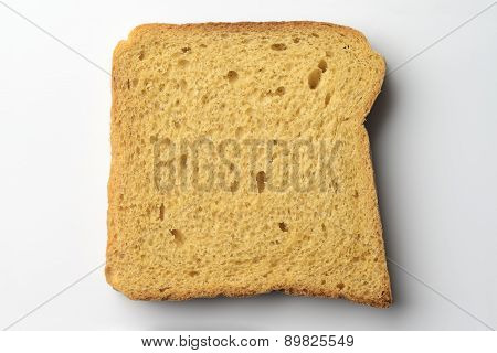 Whole wheat brown bread slice on white background.