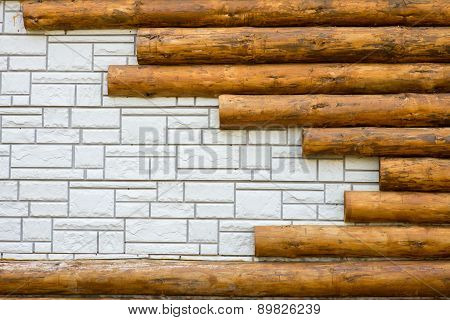 Background texture of white brick combined with logs