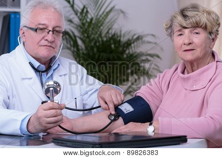 Elder Woman Controlling Blood Pressure