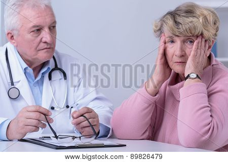 Worried Woman In Doctor's Office