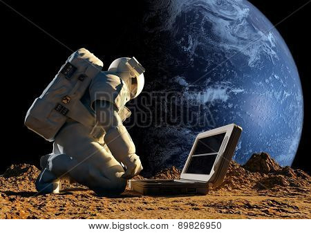 Astronaut on his knees near the solar battery.