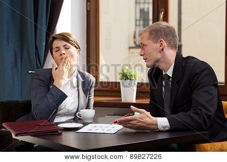 Businesswoman Yawning During Meeting