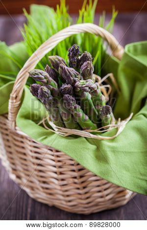 Fresh green asparagus in basket