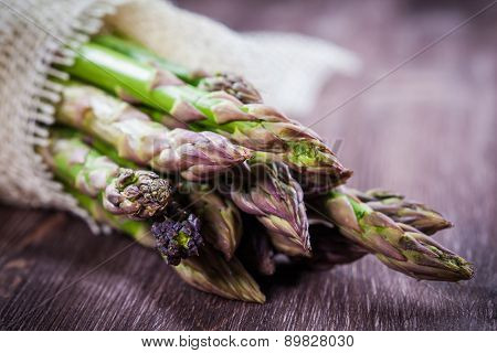 Fresh green asparagus on wooden table