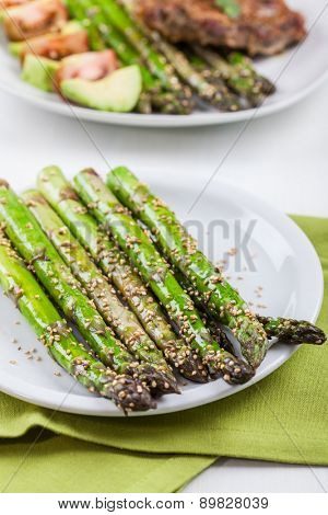 Glazed green asparagus with sesame seeds
