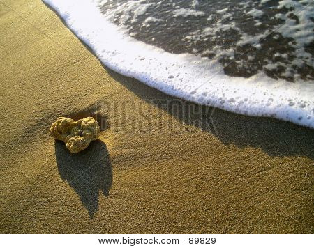 Pebble And Wave On Beach