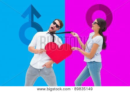 Brunette pulling her boyfriend by the tie against pink and blue