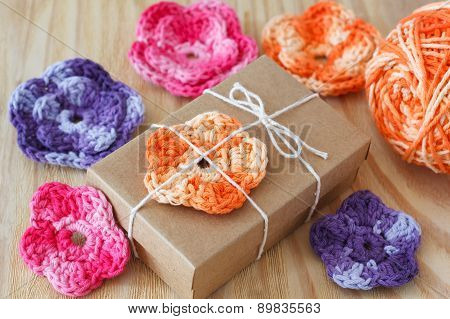 Handmade colorful crochet flowers for decoration of gift with skein