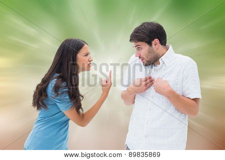 Angry brunette shouting at boyfriend against digitally generated dandelion seeds on green background