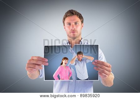 Woman arguing with ignoring man against grey vignette