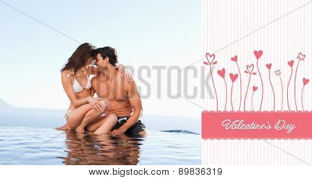 Couple on the pool edge against valentines graphic