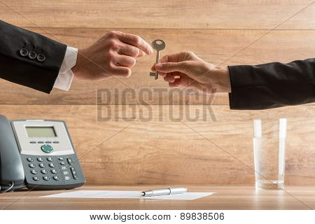 Businesswoman Handing Over A House Key