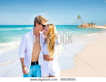 Blond teen couple walking together in the tropical beach at Caribbean sea in Mexico photo mount
