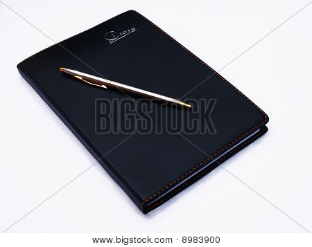 Book, diary and pen with blank pages isolated over white background