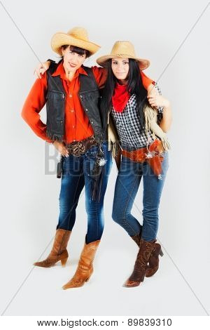 two girls in costumes of cowboys