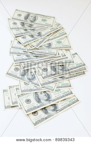 lot of 100 dollar bills on a white background