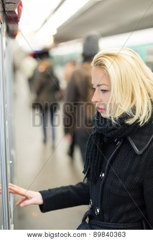 Lady buying ticket for public transport.