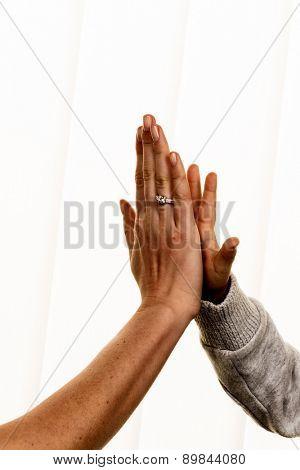 high five gesture, symbol of success, security, closeness, trust