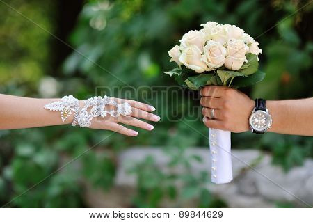 Groom Transmits Give Bride Wedding Bouquet Of White Roses