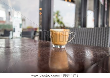 Coffe Latte Cup On A Wood Table