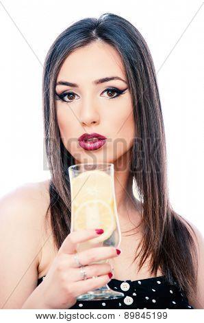 Girl drinking lemonade, isolated on white