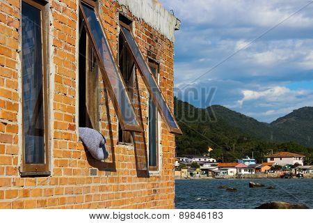 Brick beach house with open windows