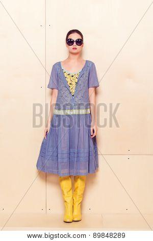 Full body slim woman in blue sundress