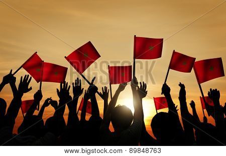Silhouettes of People Holding the Flag of Morocco
