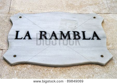 La Rambla- Street Sign Depicting One Of The First Landmark In Barcelona