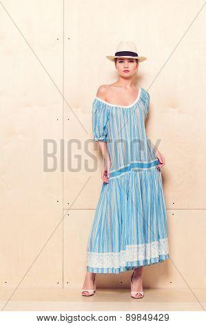 Full-length portrait of a lovely woman in romantic dress