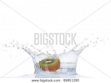 Fresh kiwi in water splash isolated on white background