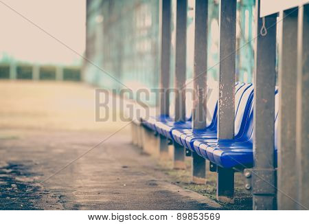 Staff and player bench at baseball field