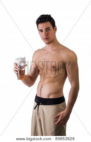 Athletic shirtless young man holding protein shake bottle, ready for drinking