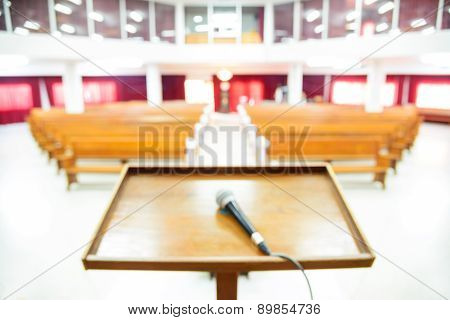 Blurred Interior View Of A Modern Church With Empty Pews