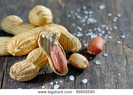 peanut and salt on wooden background