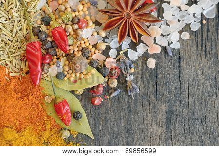 Herbs and spices on old table wood