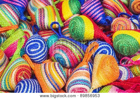 Close Up Stack Of Colorful Handmade Coin Bag In Market