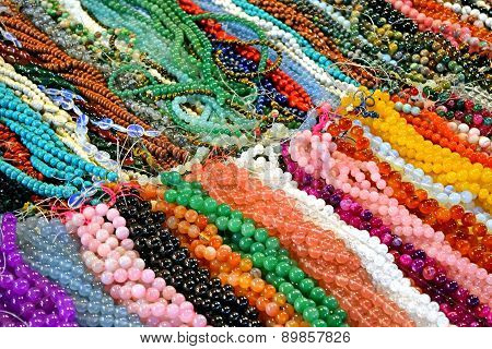 Collage of a variety of beads for necklaces