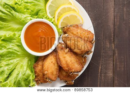 Top View Fried Chicken Wings On Wooden Background