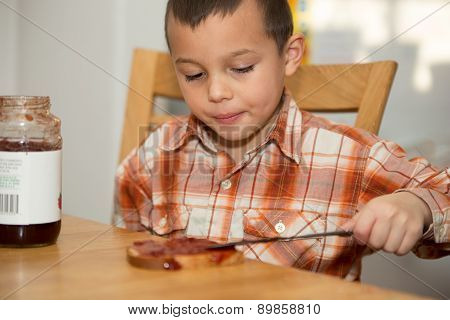 Young Boy 4-6 Years Old Making Jelly Sandwich.