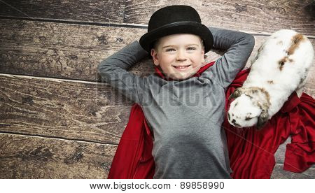 Little magician child posing with white rabbit