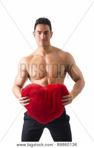 Sexy Man with Muscles Holding Red Heart Toy