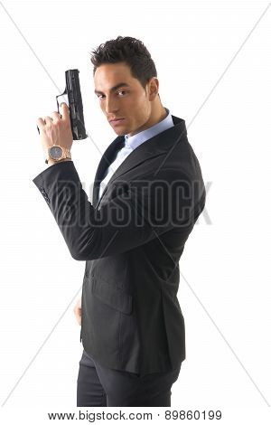 Elegant man with gun, dressed as a spy or secret agent