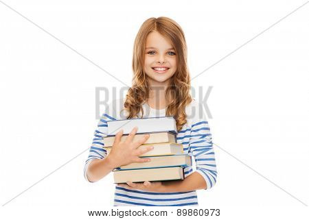 education and school concept - little student girl with many books
