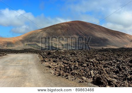 A Road On Volcanic Landscape At  Lanzarote Island, Canary Islands, Spain