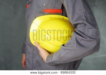Builder holding helmet in hands