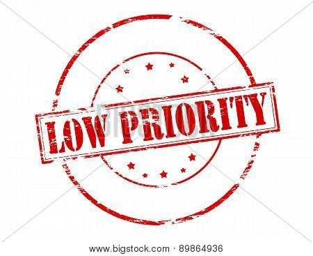 Rubber stamp with text low priority inside vector illustration