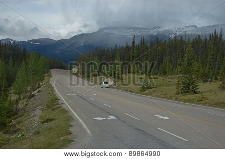 Long freeway in a mountain in Canadian Rockies forest