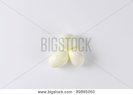 overhead view of three hard boiled eggs